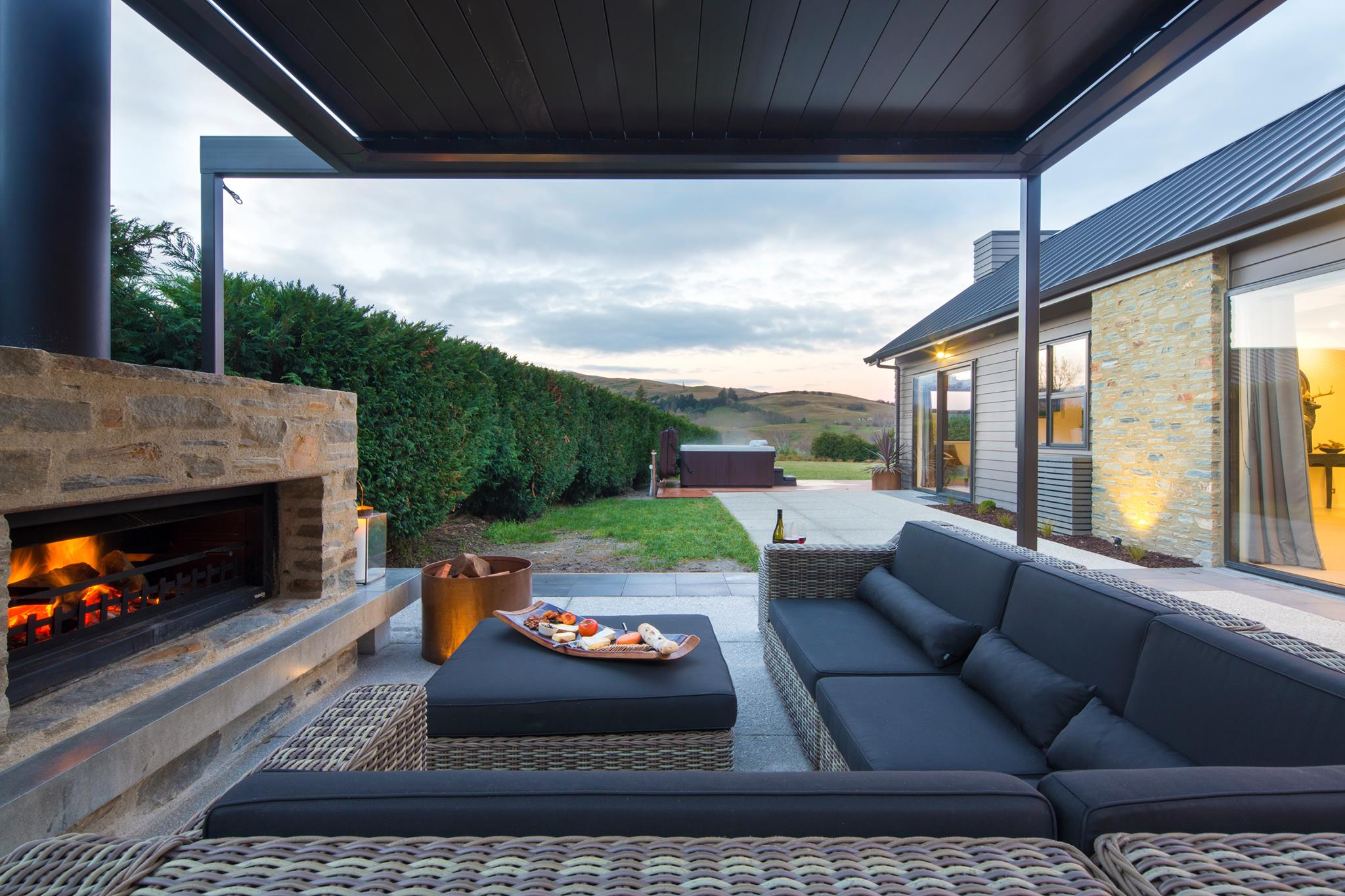 adding an outdoor fireplace to an outdoor entertaining area