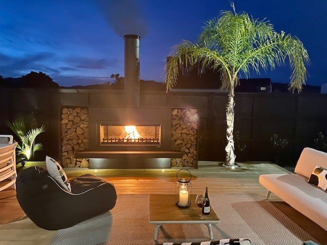 Outdoor fireplace with lighting