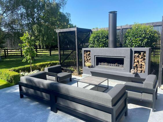 Outdoor fireplace with woodboxes
