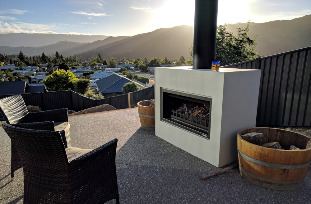 Mini-Burton outdoor fireplace  located in a stunning entertaining area