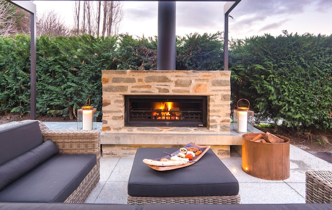 making money and delighting your guests with an outdoor fireplace