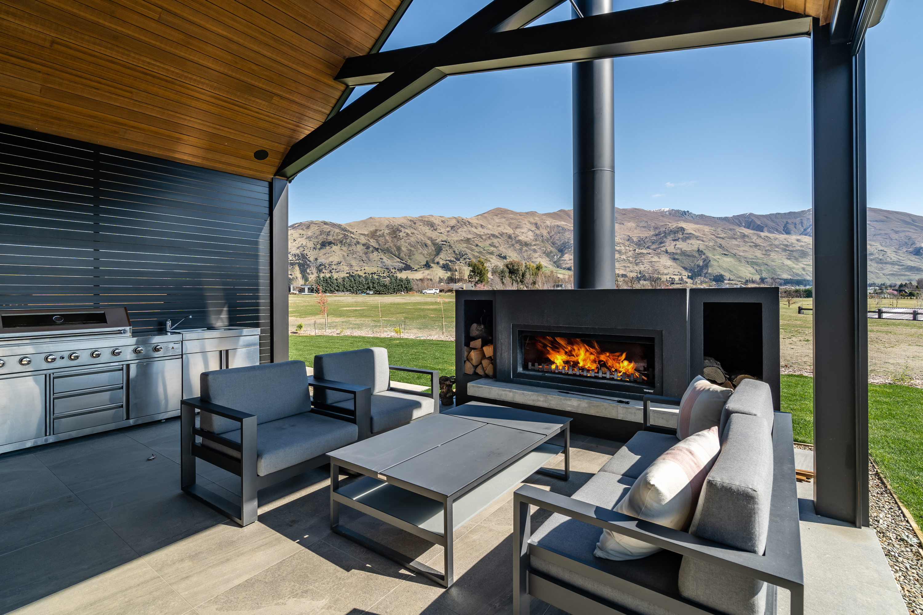 Including an outdoor fireplace in landscape design