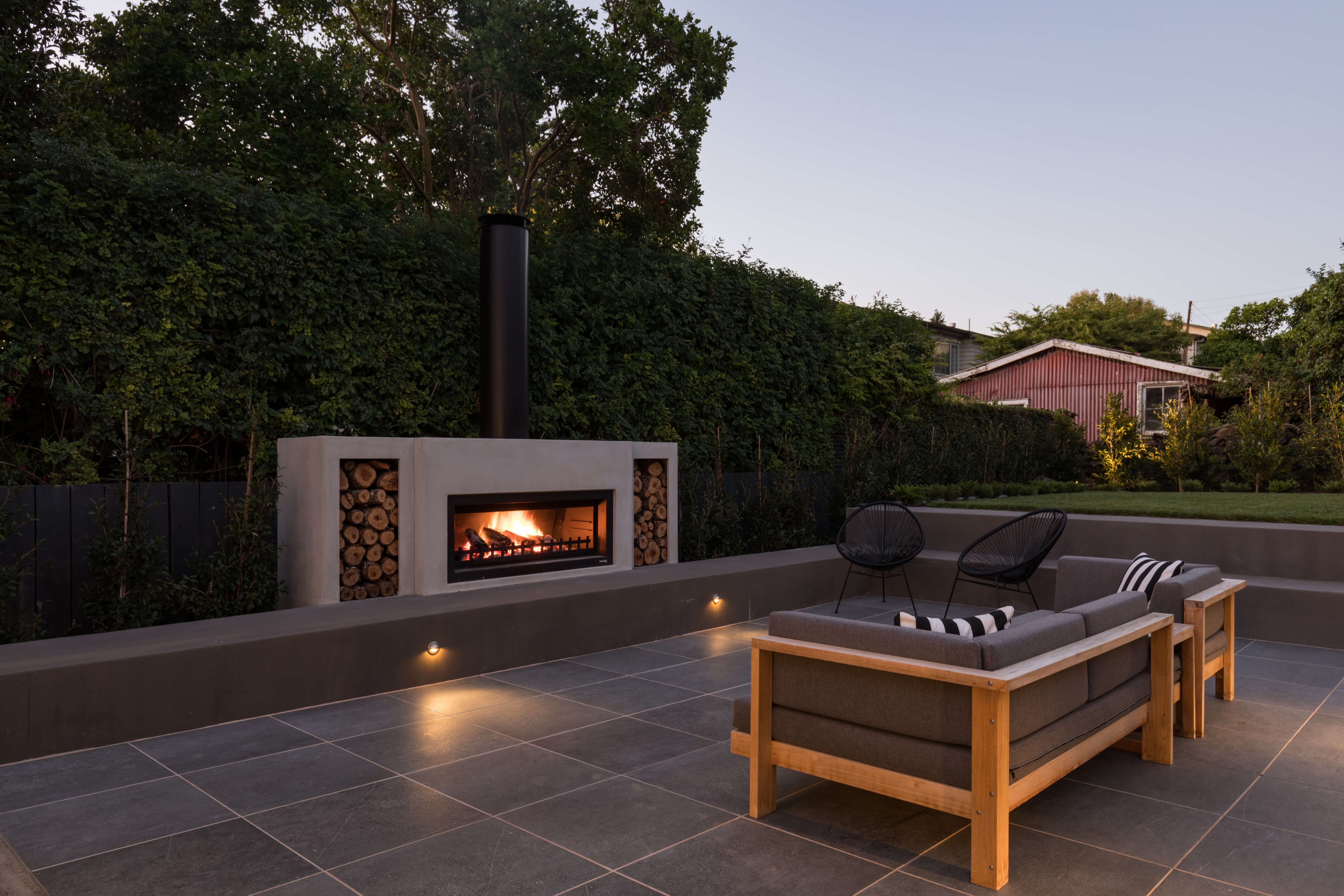 Outdoor fireplace with chimney cap