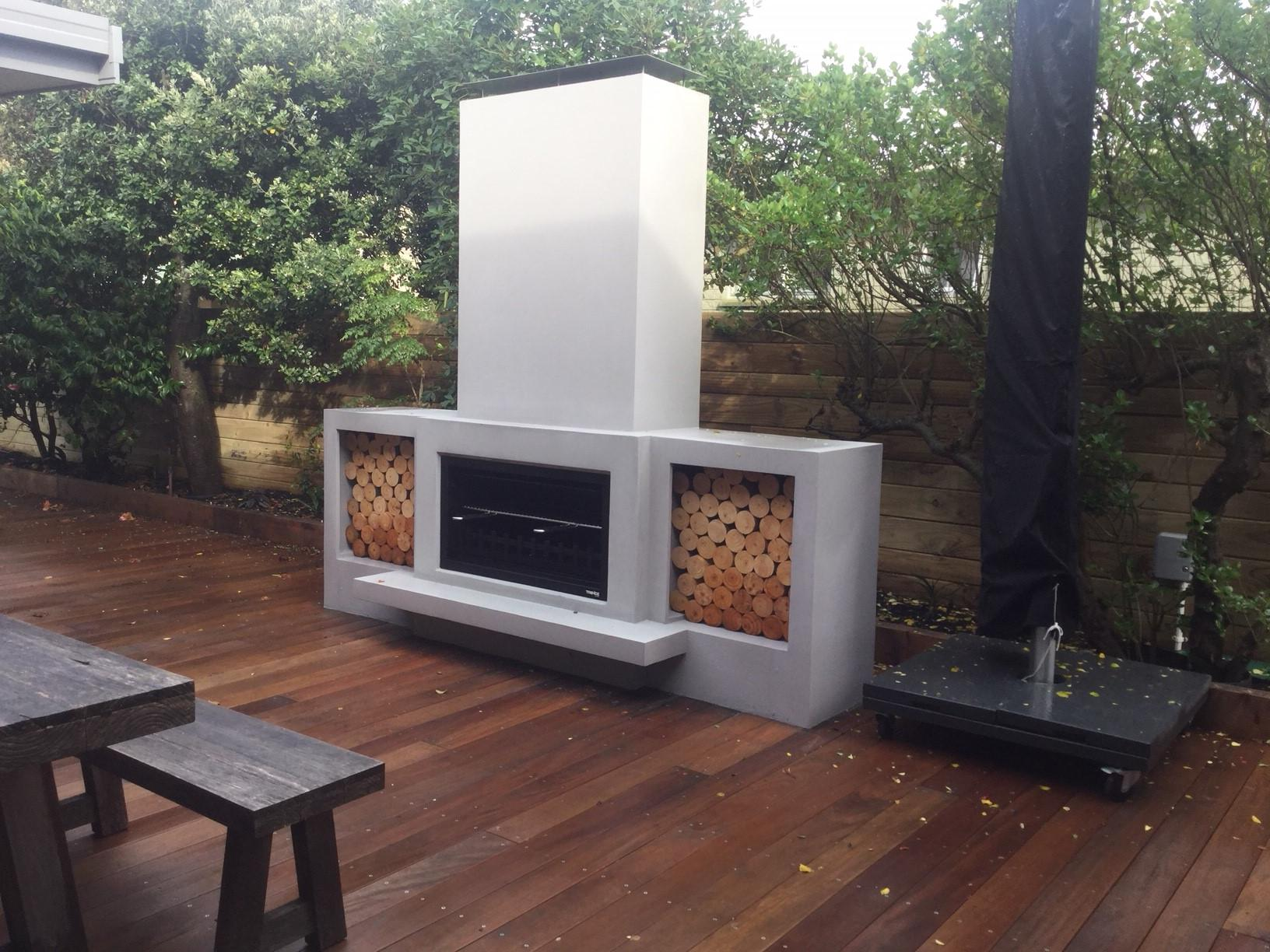 Woodboxes built into the outdoor fireplace