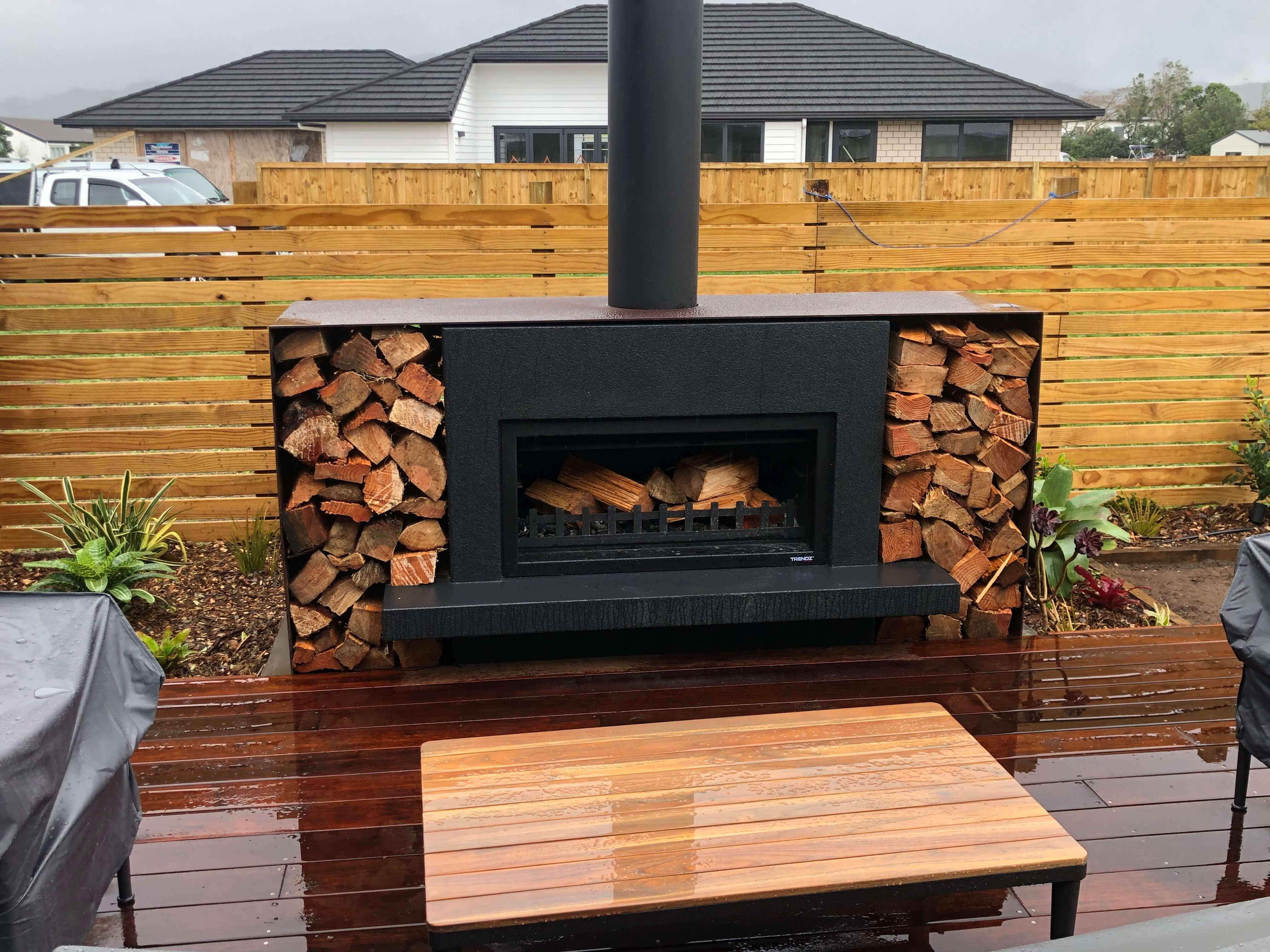 Outdoor landscaping with feature fireplace